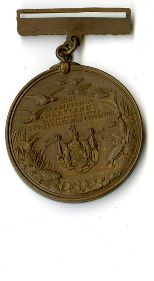 Photo of back side of the commemorative medal designed by Shelter Island artist, Walter Cole Brigham, in honor of Maryland's participation in the World's Fair: Columbian Exposition of 1893.